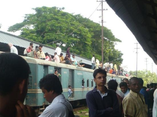 Comilla, Bangladesh : Bangali people make most use of space. They sit on the roof of the train!