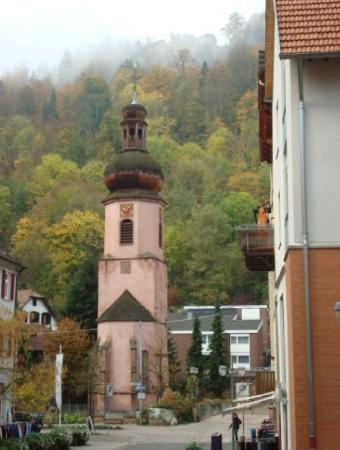 Old Catholic church with castle high atop mountain in the backround, Schramberg, Germany