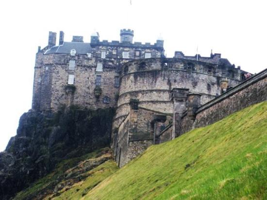 Edinburgh Castle is an ancient fortress which dominates the sky-line of the city of Edinburgh fr