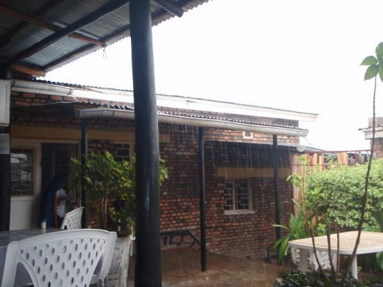 Kibungo, Rwanda: a crazy downpour, cel and i were forced to stop and have a beer to wait it out :)