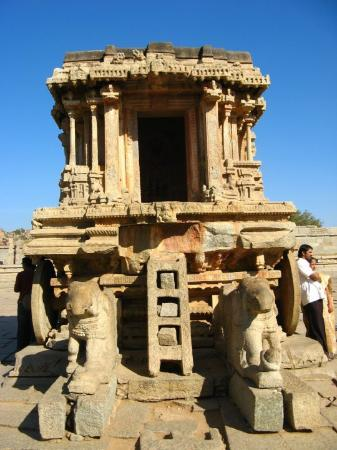 Hampi, India: the famous stone chariot guided by garuda.