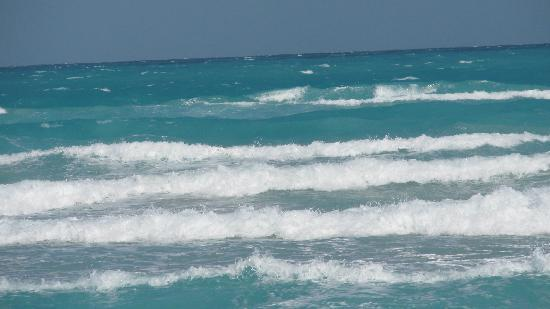 Melia Las Antillas: the last day of beach and it was windy so we rode the waves...what a blast!