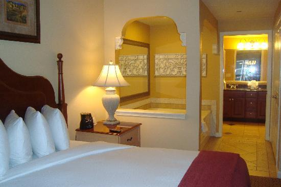 Hilton Grand Vacations at Tuscany Village: one bedroom, bedroom, hot tub and bathroom