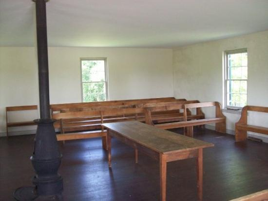 Antietam National Battlefield: Interior of the Dunker Church.  The furniture is original, as well as the wood stove.
