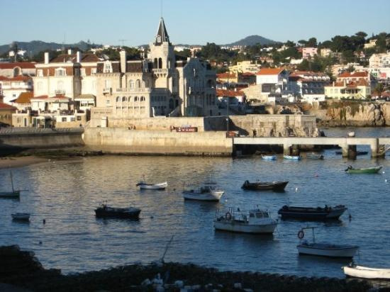 "The harbor in Cascais. That building with the black spire used to be a ""gentlemen's club,"" no wi"