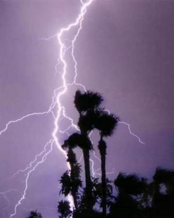 Tucson, AZ: FULL FORCE LIGHTNING             WILD EXPLOSIONS.  Awesome  but scary,  The . sky really is Purp