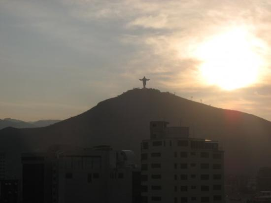 Cochabamba, Bolivia: A view of El Cristo De La Concordia at sunset. It is atop of Cerro de San Pedro behind Cochabamb