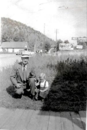 Idaho Springs, CO: My grandfather Tom Weaver who I clled Popo and me in front of the house we lived in.  It is on t
