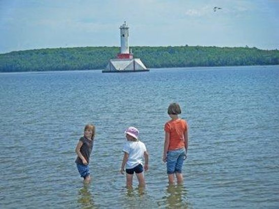 Round Lighthouse and friends playing in Lake Huron off Mackinac Island