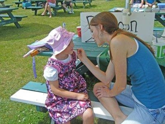 Harmony getting her face painted at the park near the Dog House on Mackinac Island
