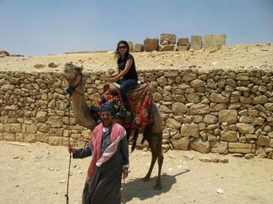 Giza, Egypt: Jenny on a camel near the pyramids