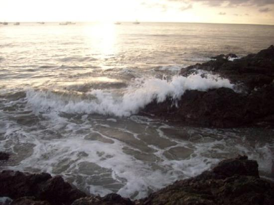 Jaco, Costa Rica: they are bigger than they look. These rocks were probably about 2-4 ft. above those waves coming