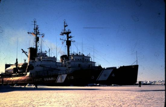 McMurdo Station: 2 Coast Guard ice breakers tied up side by side in the ice. Deep Freeze 1980.