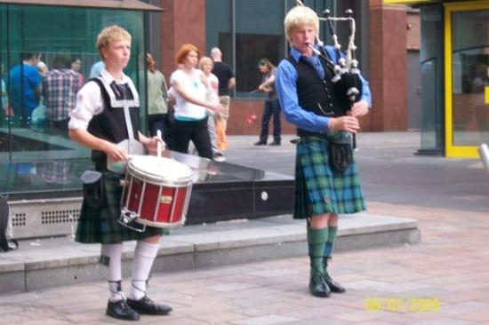 Glasgow, UK: Lads playing pipes and drums