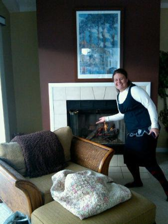 Saugatuck, MI: Shannon Showcasing the Fireplace in our Suite