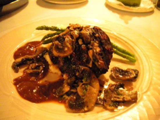 Collage Restaurant: Very tender steak w/mushrooms and their signature sauce (very good)