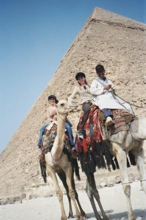 Giza, Egypt: me and m om on camel and me sitting behind a really smelly, as in big time BO smelly, guy