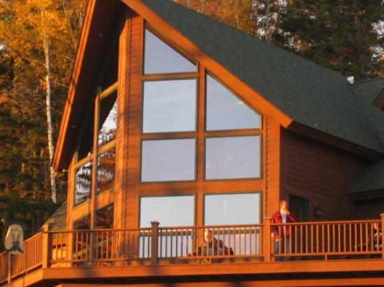 Bretton Woods, NH: My brother out on his deck. Nice shack.....huh