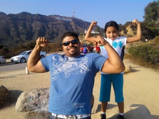 Vest-Hollywood, CA: showin off our guns... hers are bigger... lol...