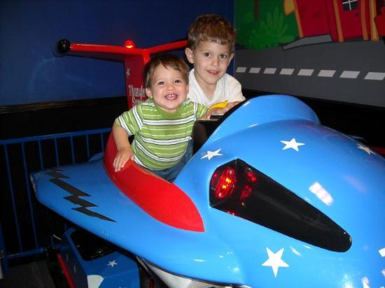 San Antonio's Incredible Pizza Company: Nathan & Ryan ride the airplane. (It moves up & down.) Nathan seems to be enjoying this ride.