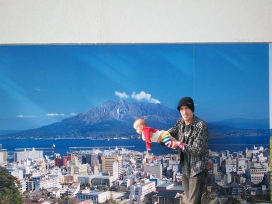 Kagoshima, Japan: Goofing off in front of a pic of the volcano, at airport