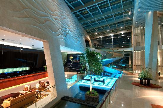 Hilton Bandung: Spacious sun drenched lobby with one of the kind 360 degrees spiral staircase