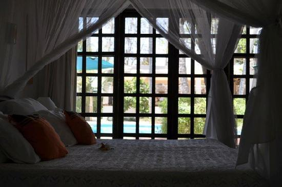 Diani Blue: The room, with a window facing the pool.