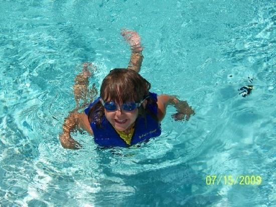 Days Inn & Suites by Wyndham Port Richey: my granddaugther swimming at the pool