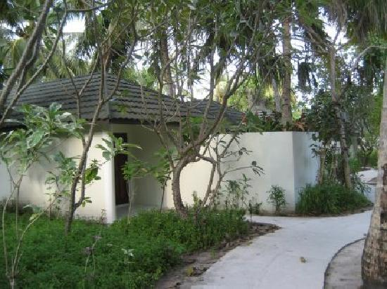 Holiday Island Resort & Spa: The rear of our bungalow showing the concrete path