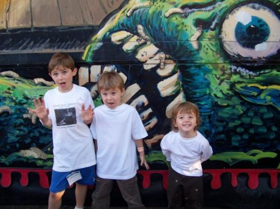 Shreveport, LA: Reece, Ayden and Ryder in front of the scary ride