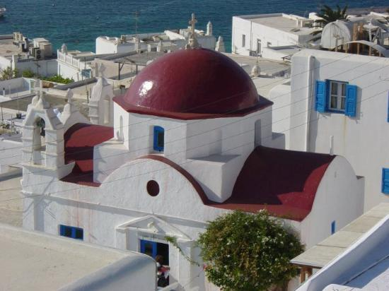 Mykonos by, Hellas: View of the town from Windmill on hill. With another church in the foreground