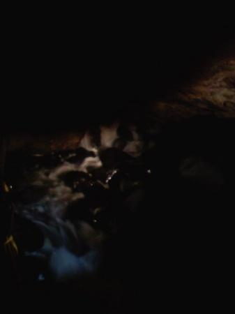 Pottersville, NY: Dark yes ... but the falls inside the caves were awesome and had to try to share