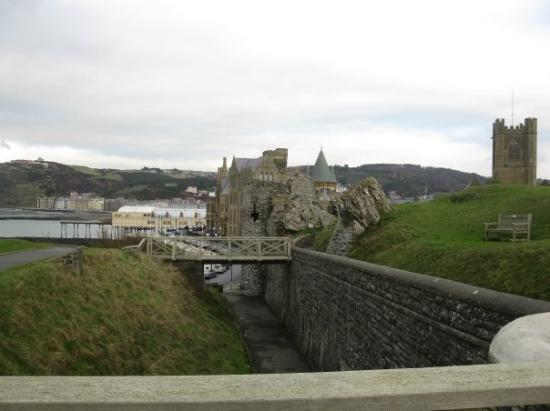 Aberystwyth, UK: Town of Aber from 1 of 2 Castle Bridges.  In the foreground is the University's main building.