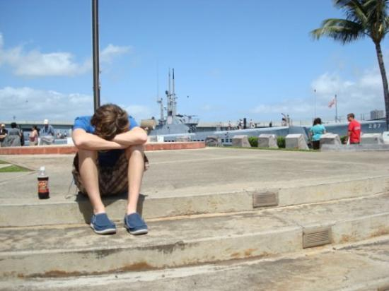 joe mourning the dead/lost servicemen at pearl harbor