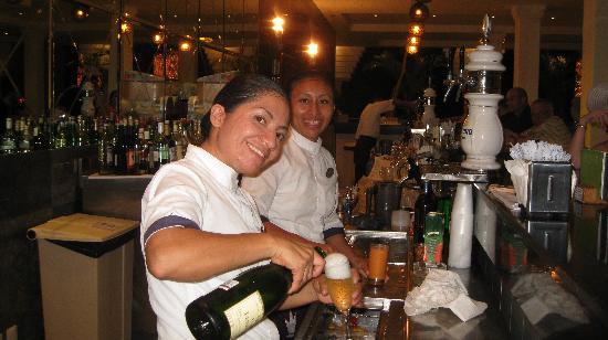 Grand Sunset Princess All Suites Resort: Erika & Maria at lobby bar hard at work.