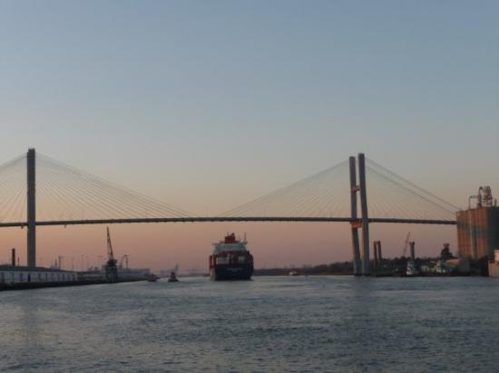 The Savannah River at sunset.  One of the many big ships passing under the bridge.