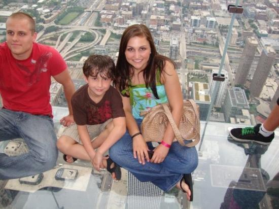 Skydeck Chicago - Willis Tower: Me and Nick sitting on the Sky ledge,  103 floors up. woo!
