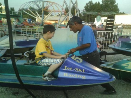 Saint James, MO: Austin saw the water skiis and just had to give them a go. The dude helped him get strapped in.