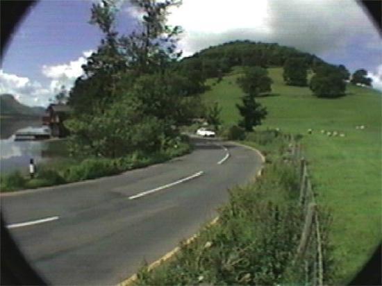 Ambleside, UK: Roadway beside Lake Ullswater, England.