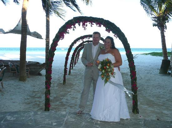 Pinewood Beach Resort & Spa: The staff made a beautiful archway of flowers for the procession to the beach