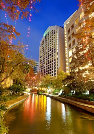As the sun sets on the Holiday Inn Riverwalk