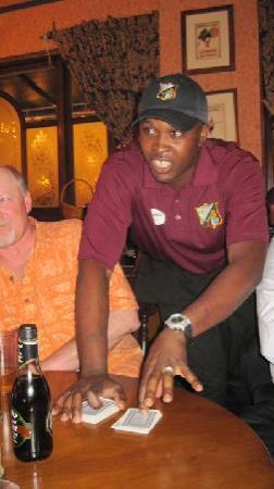 Sandals Royal Bahamian Spa Resort & Offshore Island: Ranell doing card tricks at Crickett's Pub.