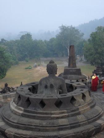 Borobudur, Indonesia: Monks praying at sunrise Borobodur, Yogyakarta, Java