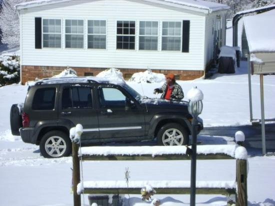 Walnut Cove, NC: My jeep and Mark cleaning it off.
