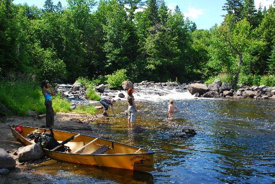 Algonquin Provincial Park, Canada: Playing in the river at the end of one of our portages, moments like this are charished for ever