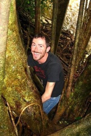 Lihue, HI: Climbing a tree at Kipu Falls