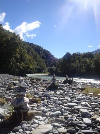 """Okarito, New Zealand: There were said to be """" blue pools"""" lol they were flooded. But some random people had built ston"""