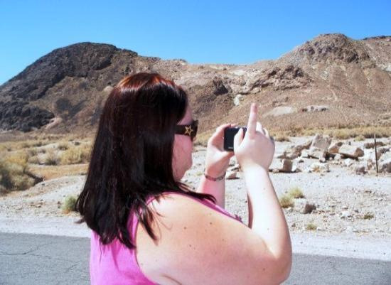 Pahrump, NV: somewhere in the NV deseret 10/2009 (Rhyolite Ghost town) Kim taking her parent's picture