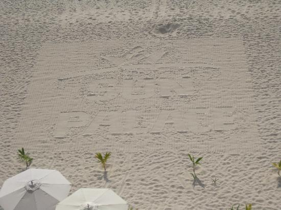 Sun Palace written in the sand each morning.
