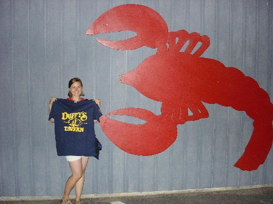 North Kingstown, RI: My wife by the big lobster outside of Duffy's after a great meal!